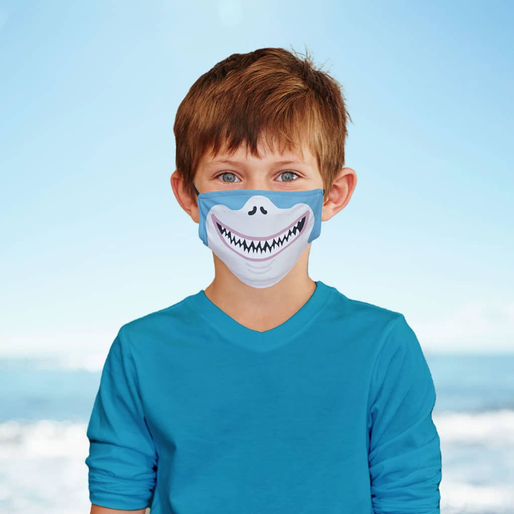 Young boy wearing shark face mask