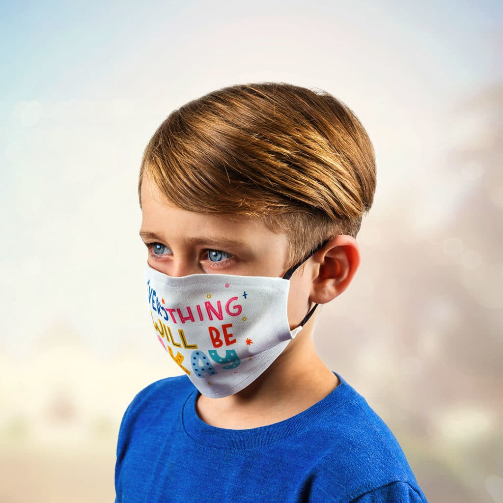 """Young boy wearing face mask that says """"Everything will be okay"""""""