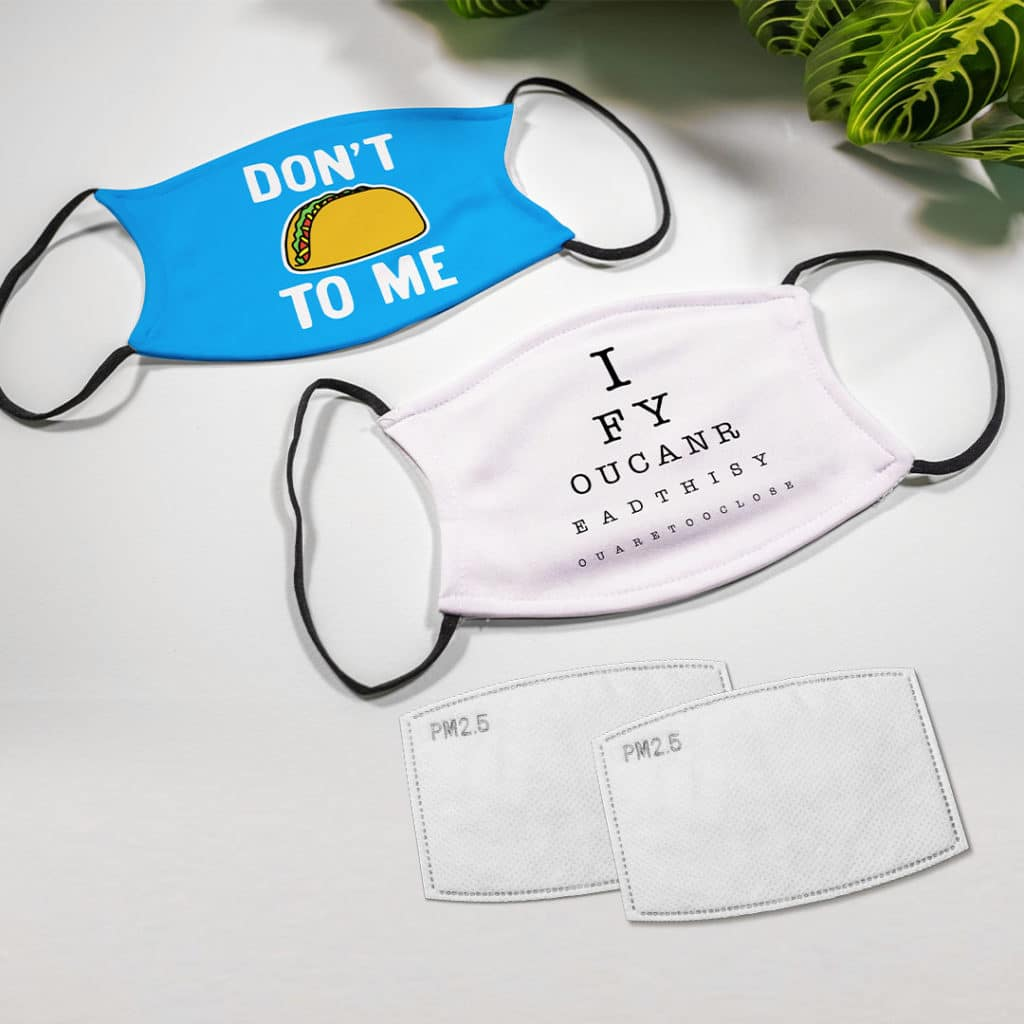 Flat lay photo of face masks with quotes and text